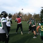 QB Reid Herchenbach lets it fly as the defense closes in